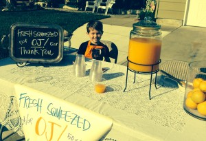 Augustus sells orange juice for Books For Treats
